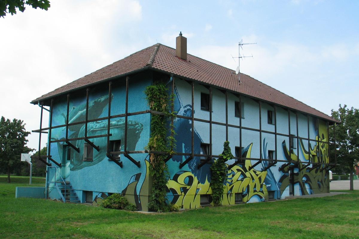 Fassadengestaltung mit Graffiti im Auftrag